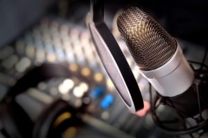 Recording equipment in studio. Studio microphone with headphones and mixer background. Elevated view